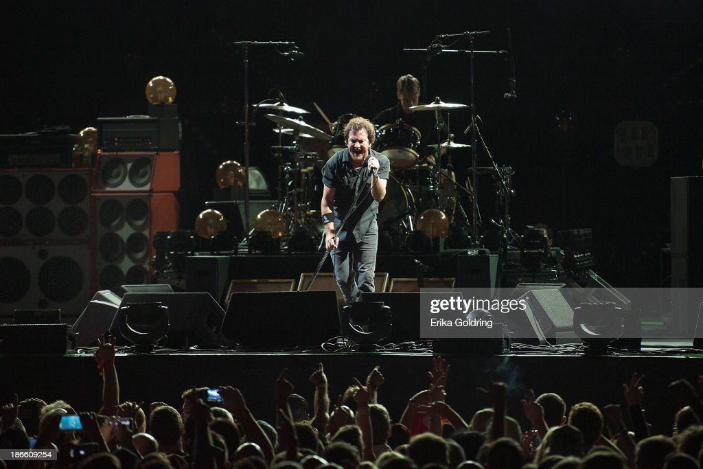 <a gi-track='captionPersonalityLinkClicked' href=/galleries/search?phrase=Eddie+Vedder&family=editorial&specificpeople=208156 ng-click='$event.stopPropagation()'>Eddie Vedder</a> and <a gi-track='captionPersonalityLinkClicked' href=/galleries/search?phrase=Matt+Cameron&family=editorial&specificpeople=4150964 ng-click='$event.stopPropagation()'>Matt Cameron</a> of Pearl Jam perform at the 2013 Voodoo Music + Arts Experience at City Park on November 1, 2013 in New Orleans, Louisiana.