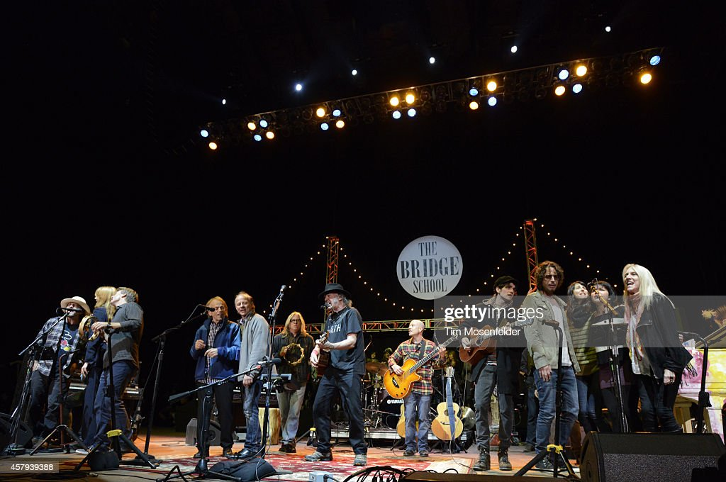 Eddie Vedder, Florence Welch, Al JardineNeil Young, Micah Nelson, Chris Cornell, Norah Jones, Catherine Popper, and Pegi Young perform during the 28th annual Bridge School Benefit Finale at Shoreline Amphitheatre on October 26, 2014 in Mountain View, California.