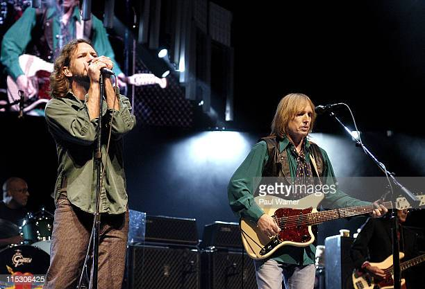 Eddie Vedder left performs with Tom Petty right and the Heartbreakers