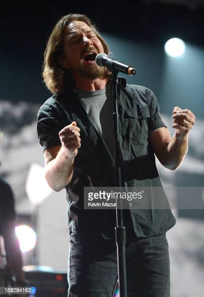 Eddie Vedder performs with Roger Waters at '121212' a concert benefiting The Robin Hood Relief Fund to aid the victims of Hurricane Sandy presented...