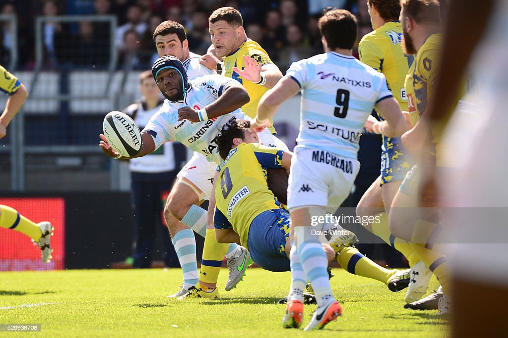 Eddy Ben Arous of Racing 92 is tackled by Morgan Parra of Clermont during the French Top 14 rugby union match between Racing 92 v Clermont at Stade Yves Du Manoir on May 1, 2016 in Colombes, France.