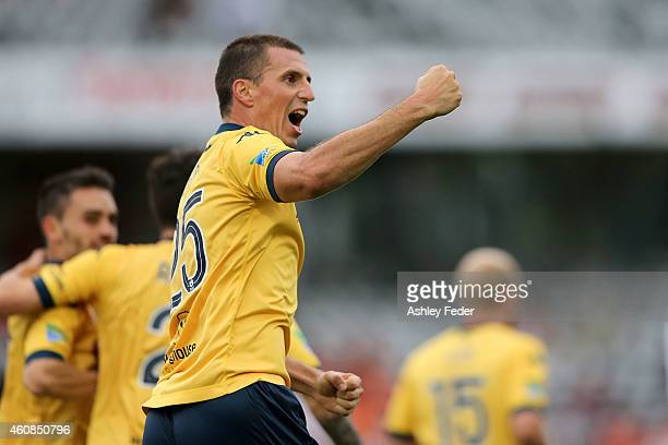 Eddy Bosnar of the Mariners celebrates a goal with team mates during the round 13 ALeague match between the Central Coast Mariners and the Brisbane...