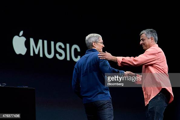 Eddy Cue senior vice president of Internet Software and Services at Apple Inc right greets Tim Cook chief executive officer of Apple Inc on stage...