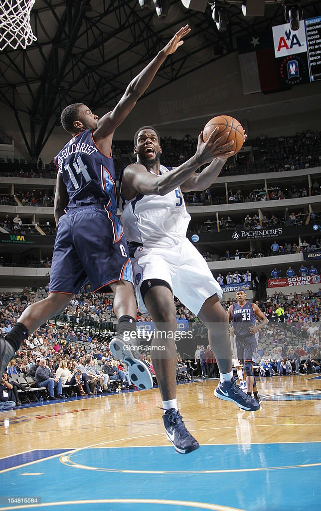 <a gi-track='captionPersonalityLinkClicked' href=/galleries/search?phrase=Eddy+Curry&family=editorial&specificpeople=201997 ng-click='$event.stopPropagation()'>Eddy Curry</a> #52 of the Dallas Mavericks goes in for the layup against <a gi-track='captionPersonalityLinkClicked' href=/galleries/search?phrase=Michael+Kidd-Gilchrist&family=editorial&specificpeople=8526214 ng-click='$event.stopPropagation()'>Michael Kidd-Gilchrist</a> #14 of the Charlotte Bobcats on October 26, 2012 at the American Airlines Center in Dallas, Texas.