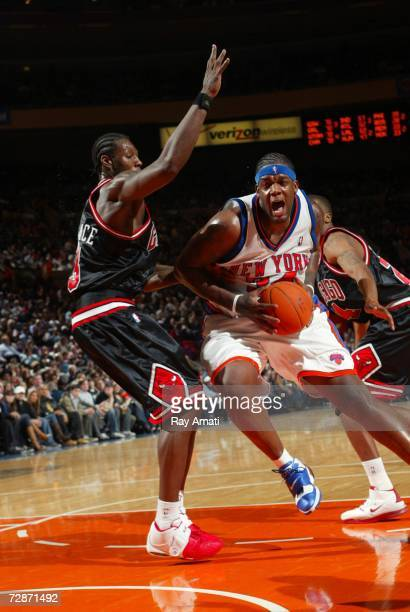 Eddy Curry of the New York Knicks drives past Ben Wallace of the Chicago Bulls during the game on December 22 2006 at Madison Square Garden in New...