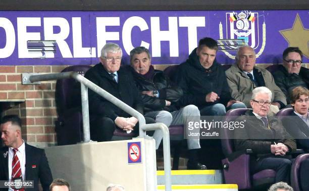 Eddy Merckx and his son Axel Merckx attend the UEFA Europa League quarter final first leg match between RSC Anderlecht and Manchester United at...