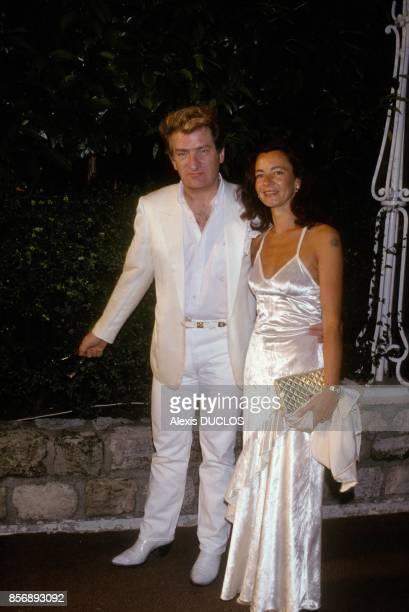 Eddy Mitchell avec sa femme Muriel lors du mariage d'Eddie Barclay le 3 juin 1988 a Paris France