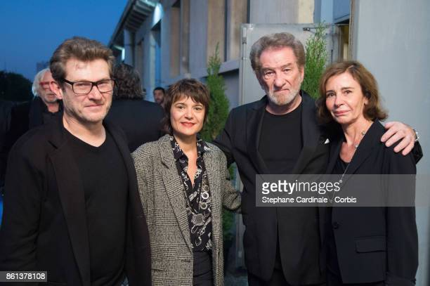 Eddy Mitchell his wife Muriel Bailleul and his son Eddy Moine with his wife attend the Opening Ceremony of the 9th Film Festival Lumiere on October...
