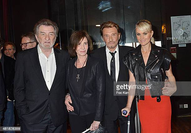 Eddy Mitchell Muriel Moine Johnny Hallyday and Laetitia Hallyday attend the Moma Group President Benajamin Patou receives his friend Claude Lelouch...
