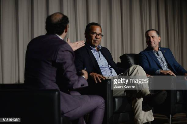 Eddy Moretti Chief Creative Officer at Vice John Viera Director of Sustainability at Ford and Philip Levine Mayor of Miami Beach speak on stage...