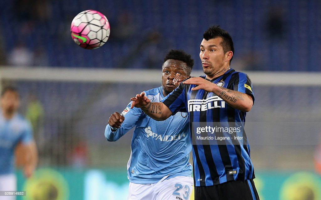 Eddy Onazi (R) of Lazio competes for the ball with Gary Medel of Inter during the Serie A match between SS Lazio and FC Internazionale Milano at Stadio Olimpico on May 1, 2016 in Rome, Italy.
