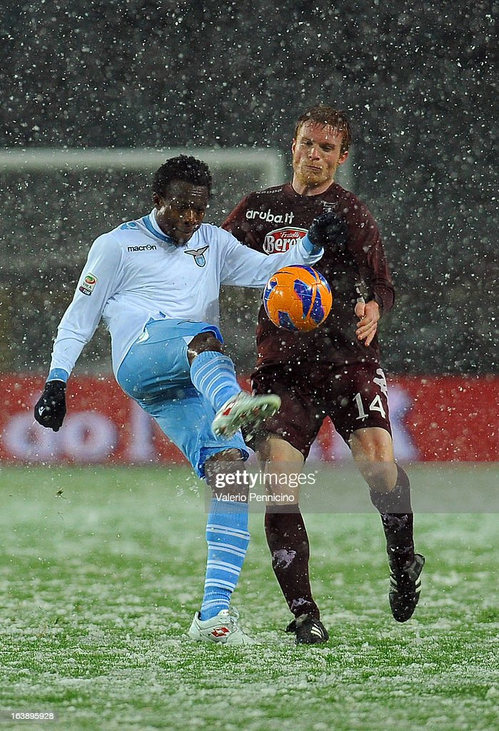 Eddy Onazi (L) of S.S. Lazio in action against Alessandro Gazzi of Torino FC during the Serie A match between Torino FC and S.S. Lazio at Stadio Olimpico di Torino on March 17, 2013 in Turin, Italy.