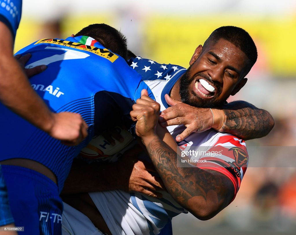 Eddy Pettybourne of the USA is tackled by Ryan Ghietti of Italy during the 2017 Rugby League World Cup match between Italy and the USA at 1300SMILES Stadium on November 5, 2017 in Townsville, Australia.