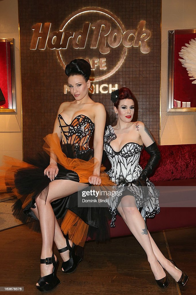 Eden and Lily of The Valley, members of the music group The Sinderellas, attend the opening of the exhibition Hard Rock Couture - Music Inspired Fashion at the Hard Rock Cafe on March 14, 2013 in Munich, Germany.