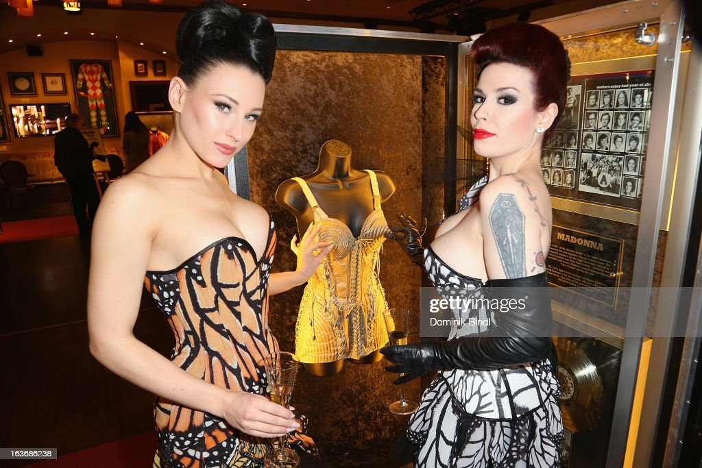 Eden and Lily of The Valley, members of the music group The Sinderellas, pose at the opening of the exhibition Hard Rock Couture - Music Inspired Fashion at the Hard Rock Cafe on March 14, 2013 in Munich, Germany.