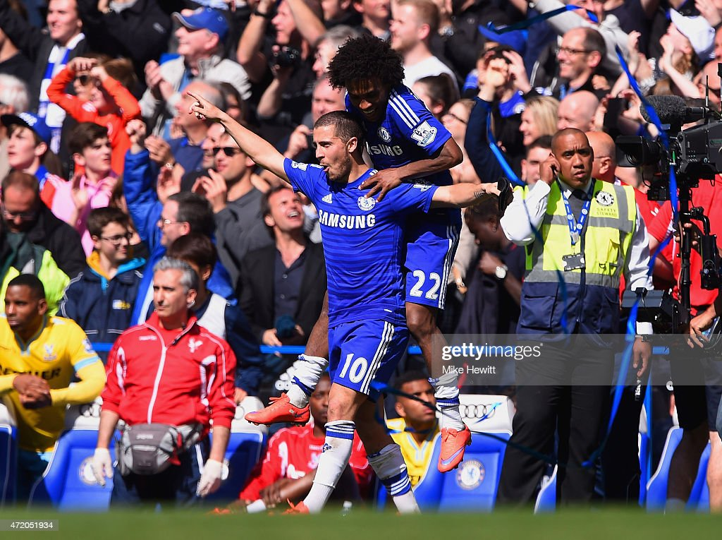 Eden Hazard (L) and Willian of Chelsea celebrate winning the Premier League title after the Barclays Premier League match between Chelsea and Crystal Palace at Stamford Bridge on May 3, 2015 in London, England. Chelsea became champions with a 1-0 victory.
