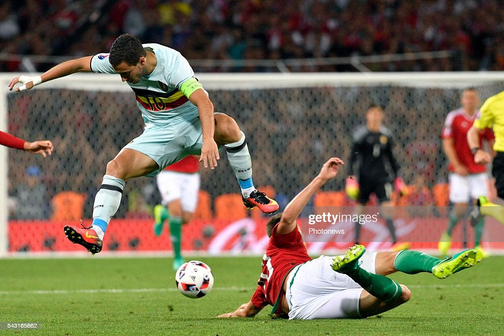 Eden Hazard midfielder of Belgium battles for the ball with Richard Guzmics defender of Hungary during the UEFA EURO 2016 Round of 16 match between Hungary and Belgium at the Stadium Toulouse on June 26, 2016 in Toulouse, France ,