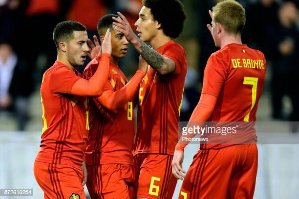 Eden Hazard midfielder of Belgium celebrates scoring the opening goal with teammates Axel Witsel midfielder of Belgium Youri Tielemans midfielder of...