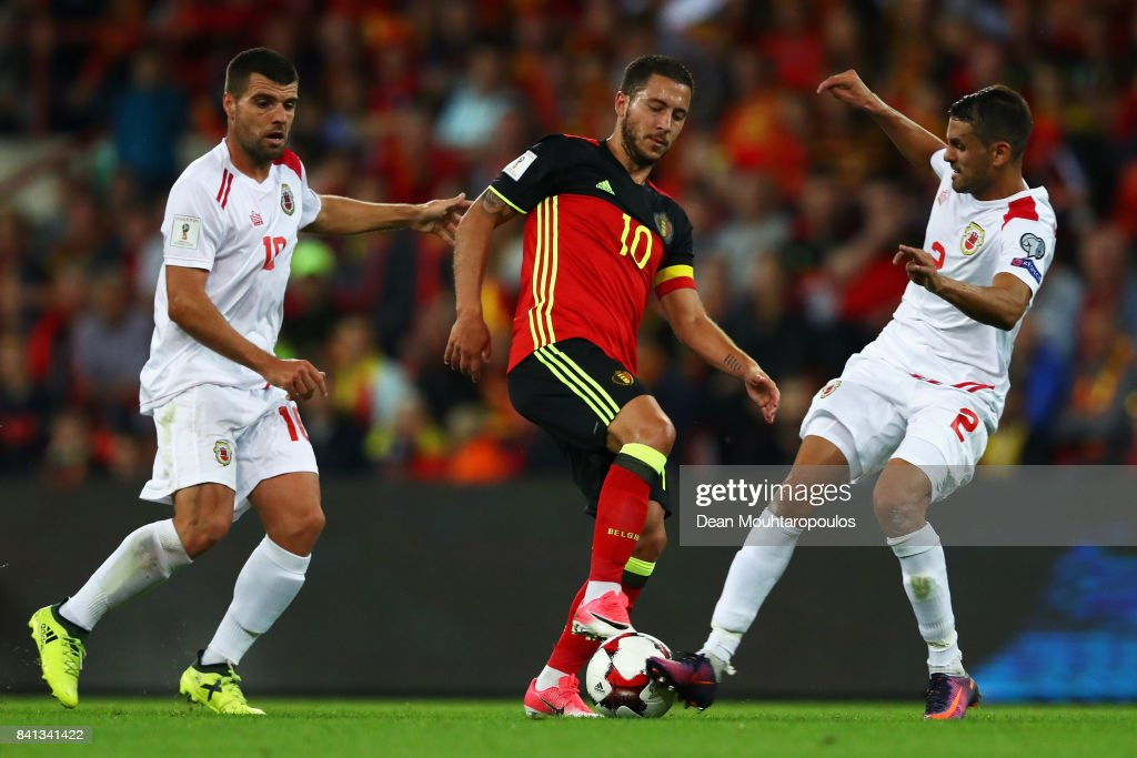 Eden Hazard of Belgium battles for the ball with Liam Walker and Jean-Carlos Garcia of Gibraltar during the FIFA 2018 World Cup Qualifier between Belgium and Gibraltar at Stade Maurice Dufrasne on August 31, 2017 in Liege, Belgium.