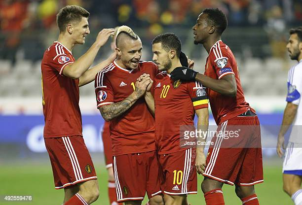 Eden Hazard of Belgium celebrates his goal with Thomas Meunier Radja Nainggolan and Divock Origi of Belgium during the UEFA EURO 2016 qualifier match...