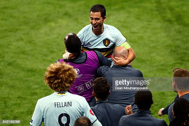 Eden Hazard of Belgium celebrates scoring his team's third goal with his team mates and staffs during the UEFA EURO 2016 round of 16 match between...