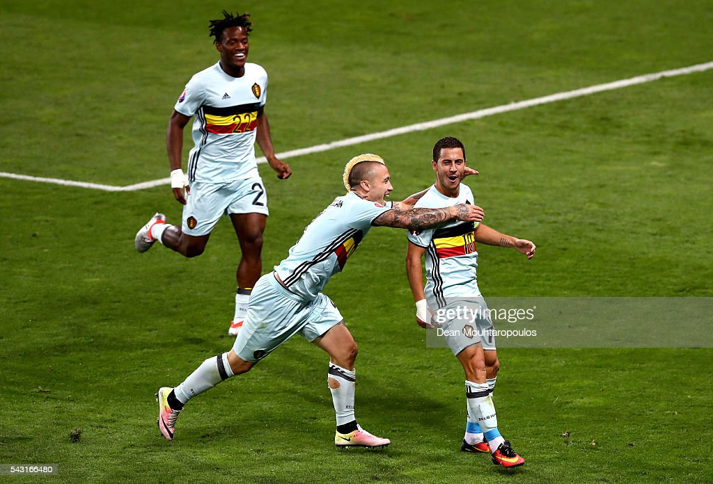 Eden Hazard (R) of Belgium celebrates scoring his team's third goal with his team mates Michy Batshuayi (L) and Radja Nainggolan (C) during the UEFA EURO 2016 round of 16 match between Hungary and Belgium at Stadium Municipal on June 26, 2016 in Toulouse, France.