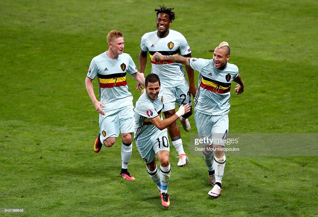 Eden Hazard (C, bottom) of Belgium celebrates scoring his team's third goal with his team mates Kevin De Bruyne (L), Michy Batshuayi (top) and Radja Nainggolan (R) during the UEFA EURO 2016 round of 16 match between Hungary and Belgium at Stadium Municipal on June 26, 2016 in Toulouse, France.