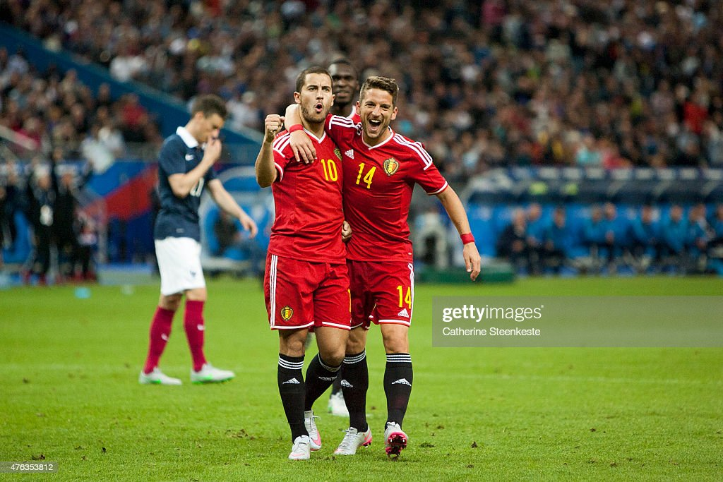 Eden Hazard #10 of Belgium celebrates with Dries Mertens #14 after scoring a penalty during the international friendly game between France and Belgium at Stade de France on June 7, 2015 in Saint Denis near Paris, France.