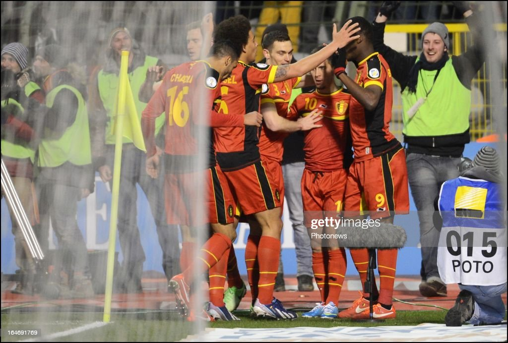 Eden Hazard (2nd R) of Belgium celebrates with his team-mates during the FIFA 2014 World Cup Group A qualifying match between Belgium and Macedonia at the King Baudouin stadium on March 26, 2013 in Brussels, Belgium