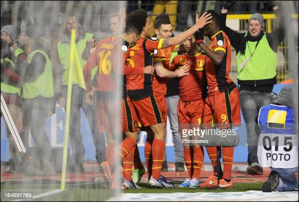 Eden Hazard of Belgium celebrates with his teammates during the FIFA 2014 World Cup Group A qualifying match between Belgium and Macedonia at the...
