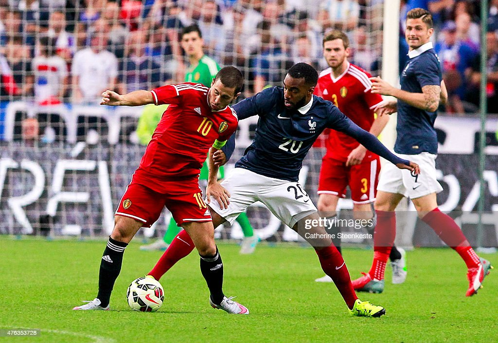 Eden Hazard #10 of Belgium controls the ball against Alexandre Lacazette #20 of France during the international friendly game between France and Belgium at Stade de France on June 7, 2015 in Saint Denis near Paris, France.