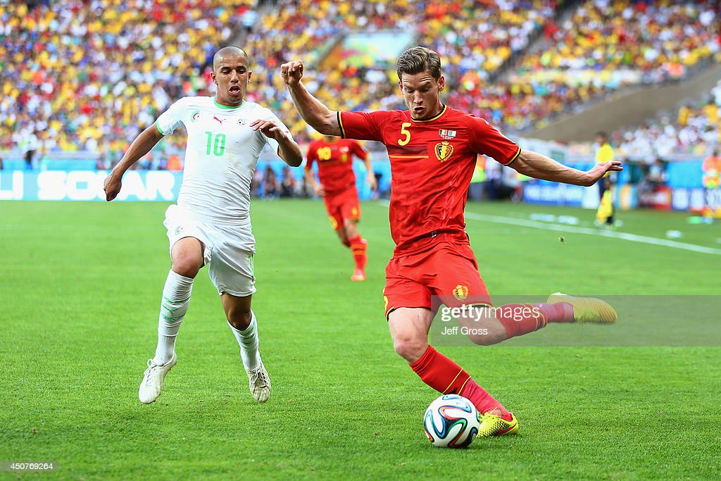 <a gi-track='captionPersonalityLinkClicked' href=/galleries/search?phrase=Eden+Hazard&family=editorial&specificpeople=5539543 ng-click='$event.stopPropagation()'>Eden Hazard</a> of Belgium controls the ball as <a gi-track='captionPersonalityLinkClicked' href=/galleries/search?phrase=Mehdi+Mostefa&family=editorial&specificpeople=6328029 ng-click='$event.stopPropagation()'>Mehdi Mostefa</a> of Algeria gives chase during the 2014 FIFA World Cup Brazil Group H match between Belgium and Algeria at Estadio Mineirao on June 17, 2014 in Belo Horizonte, Brazil.