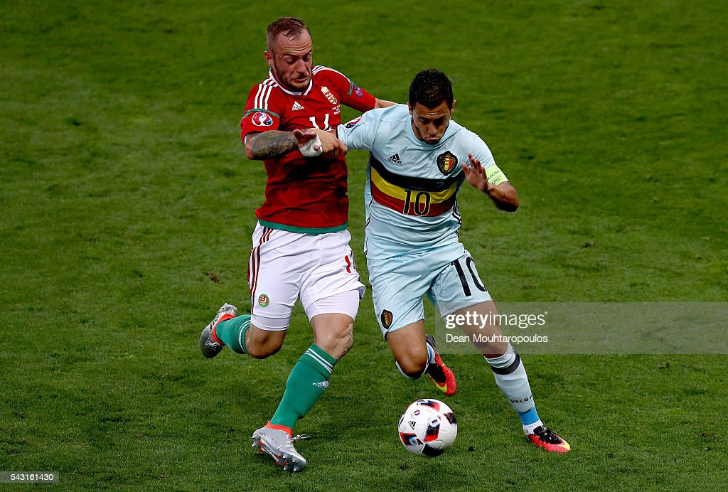 Eden Hazard of Belgium controls the ball under pressure of Gergo Lovrencsics of Hungary during the UEFA EURO 2016 round of 16 match between Hungary and Belgium at Stadium Municipal on June 26, 2016 in Toulouse, France.
