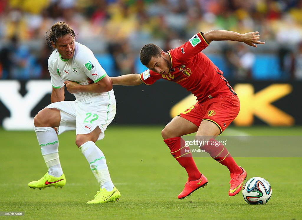 <a gi-track='captionPersonalityLinkClicked' href=/galleries/search?phrase=Eden+Hazard&family=editorial&specificpeople=5539543 ng-click='$event.stopPropagation()'>Eden Hazard</a> of Belgium fights off <a gi-track='captionPersonalityLinkClicked' href=/galleries/search?phrase=Mehdi+Mostefa&family=editorial&specificpeople=6328029 ng-click='$event.stopPropagation()'>Mehdi Mostefa</a> of Algeria during the 2014 FIFA World Cup Brazil Group H match between Belgium and Algeria at Estadio Mineirao on June 17, 2014 in Belo Horizonte, Brazil.