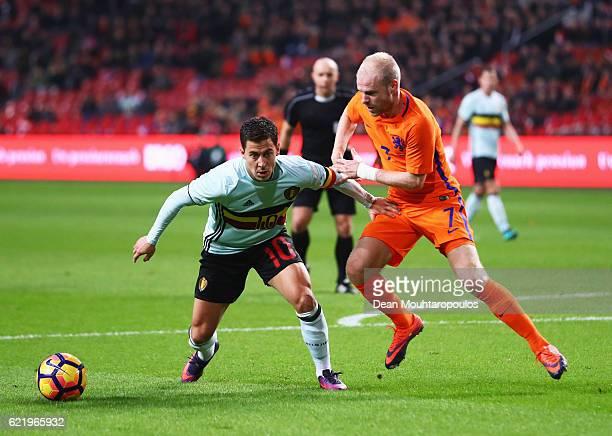 Eden Hazard of Belgium holds off Davy Klaassen of the Netherlands during the international friendly match between Netherlands and Belgium at...