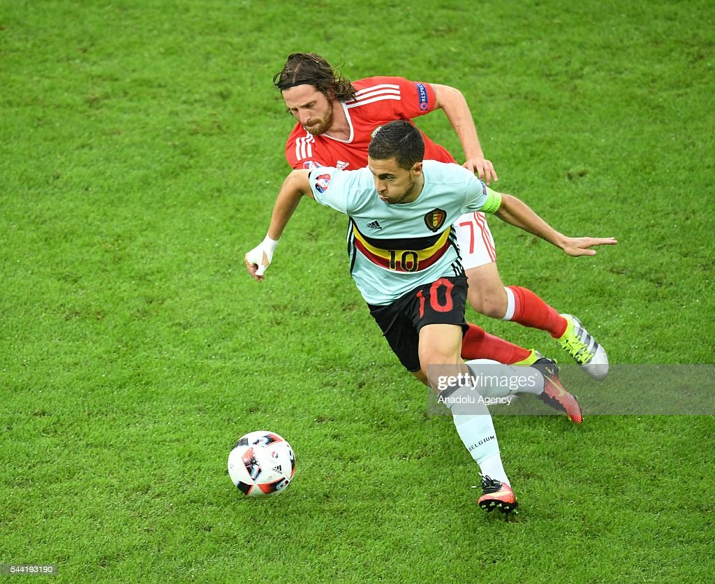 Eden Hazard (L) of Belgium in action against Joe Allen (R) of Wales during the Euro 2016 quarter-final football match between Wales and Belgium at the Stadium Pierre Mauroy in Lille, France on July 1, 2016.