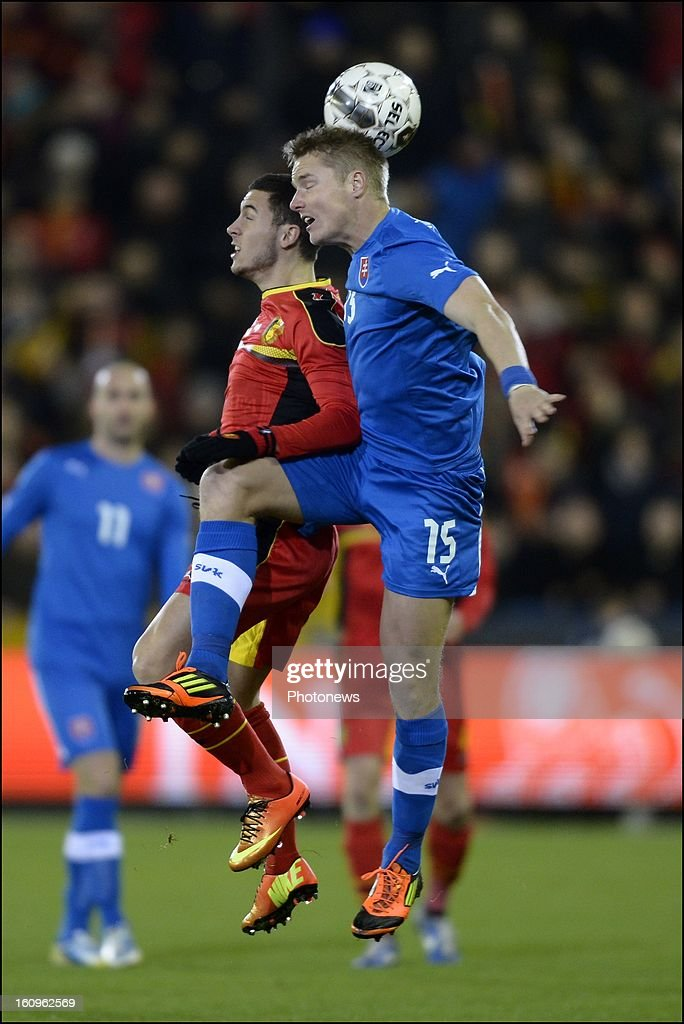 <a gi-track='captionPersonalityLinkClicked' href=/galleries/search?phrase=Eden+Hazard&family=editorial&specificpeople=5539543 ng-click='$event.stopPropagation()'>Eden Hazard</a> of Belgium in an airduel with Tomas Hubocan of Slovakia during a FIFA international friendly match between Belgium and Slovakia at theJan Breydel stadium on February 06, 2013 in Brugge, Belgium