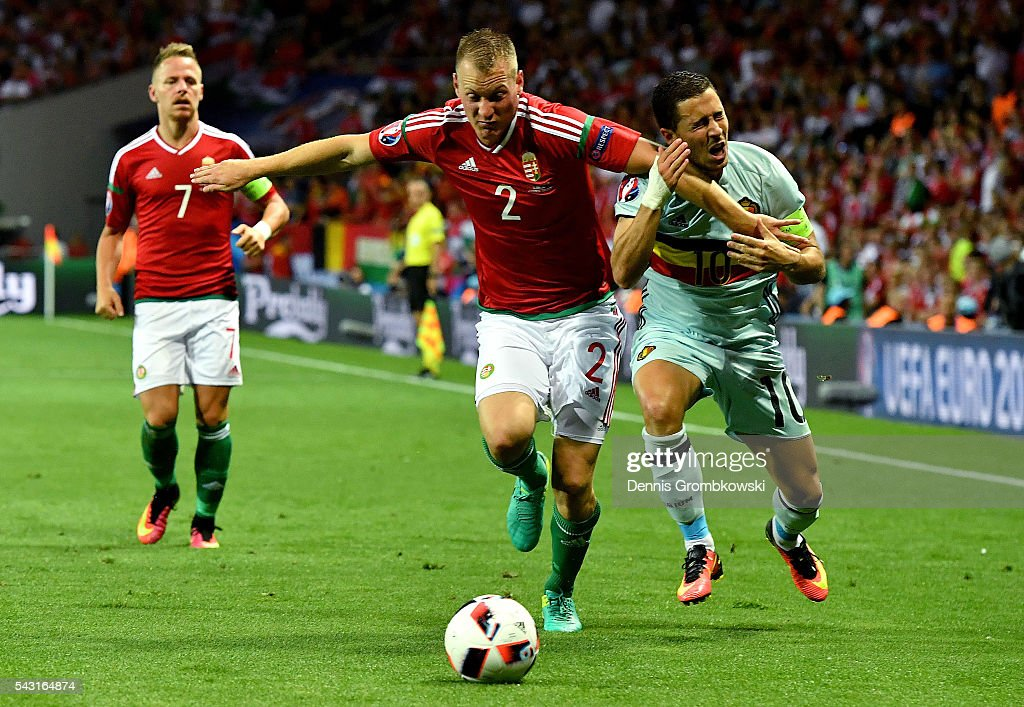 <a gi-track='captionPersonalityLinkClicked' href=/galleries/search?phrase=Eden+Hazard&family=editorial&specificpeople=5539543 ng-click='$event.stopPropagation()'>Eden Hazard</a> of Belgium is fouled by Adam Lang of Hungary during the UEFA EURO 2016 round of 16 match between Hungary and Belgium at Stadium Municipal on June 26, 2016 in Toulouse, France.