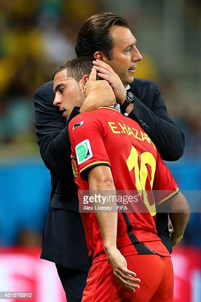 Eden Hazard of Belgium is hugged by head coach Marc Wilmots as he is replaced during the 2014 FIFA World Cup Brazil Round of 16 match between Belgium...
