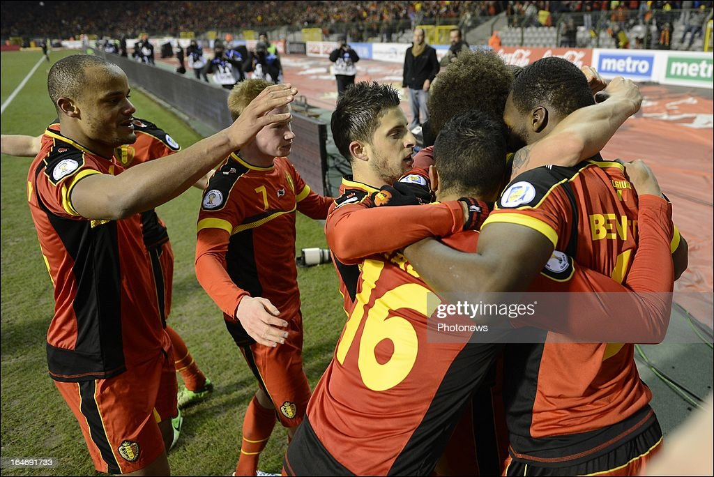 <a gi-track='captionPersonalityLinkClicked' href=/galleries/search?phrase=Eden+Hazard&family=editorial&specificpeople=5539543 ng-click='$event.stopPropagation()'>Eden Hazard</a> of Belgium of Belgium celebrates with his team-mates during the FIFA 2014 World Cup Group A qualifying match between Belgium and Macedonia at the King Baudouin stadium on March 26, 2013 in Brussels, Belgium.