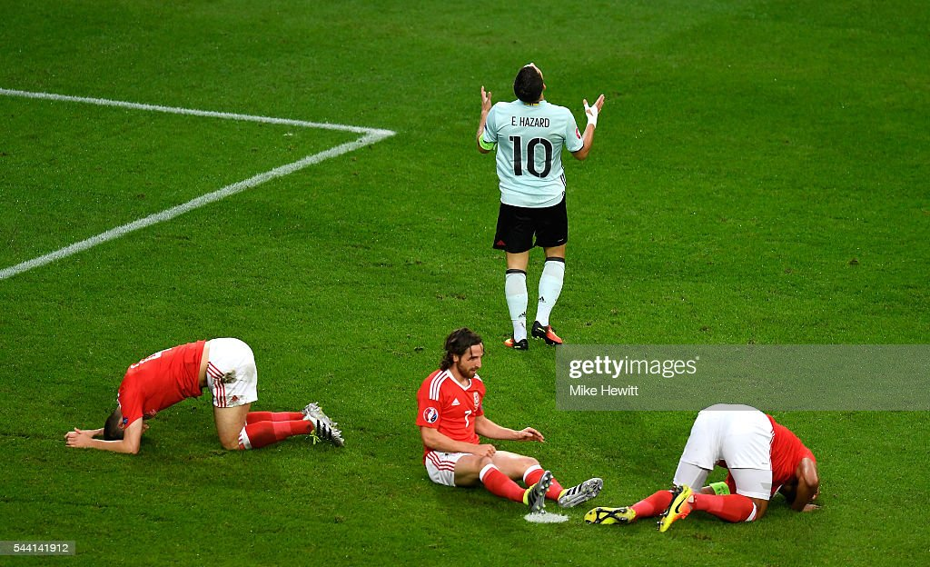 <a gi-track='captionPersonalityLinkClicked' href=/galleries/search?phrase=Eden+Hazard&family=editorial&specificpeople=5539543 ng-click='$event.stopPropagation()'>Eden Hazard</a> of Belgium reacts after his shot blocked by Wales defense during the UEFA EURO 2016 quarter final match between Wales and Belgium at Stade Pierre-Mauroy on July 1, 2016 in Lille, France.
