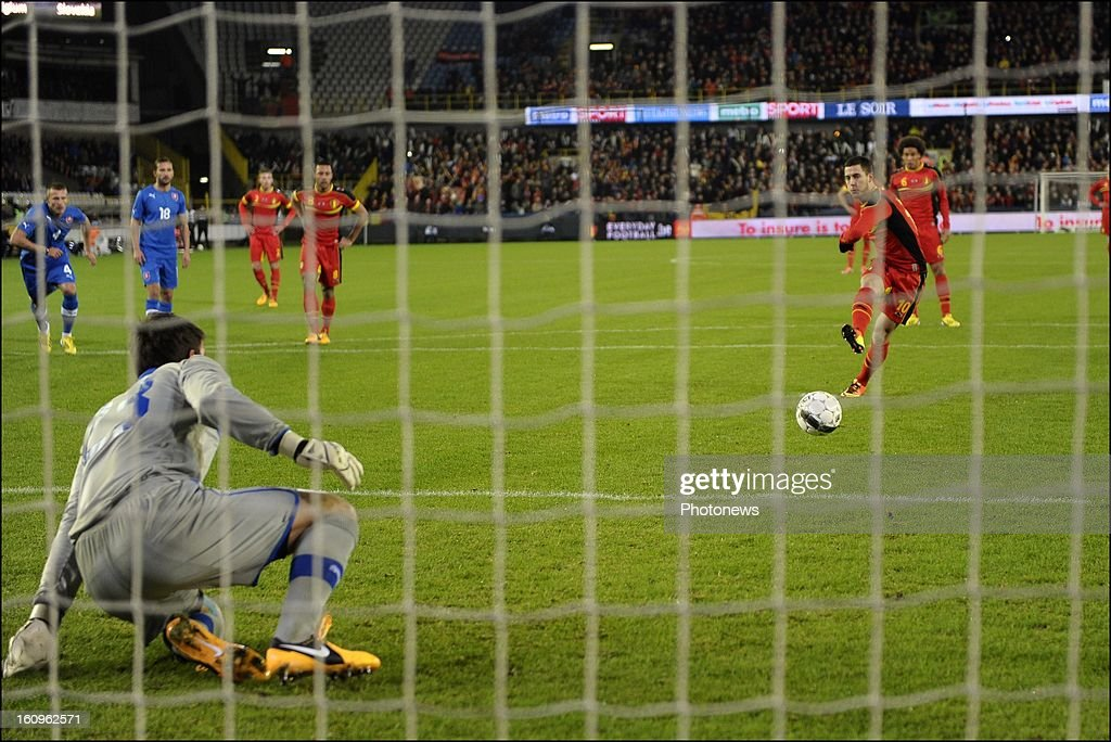 <a gi-track='captionPersonalityLinkClicked' href=/galleries/search?phrase=Eden+Hazard&family=editorial&specificpeople=5539543 ng-click='$event.stopPropagation()'>Eden Hazard</a> of Belgium scores a penalty during a FIFA international friendly match between Belgium and Slovakia at theJan Breydel stadium on February 06, 2013 in Brugge, Belgium.