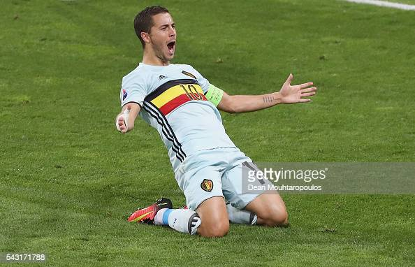 Eden Hazard of Belgium slides on his knees as he celebrates scoring his team's third goal during the UEFA EURO 2016 round of 16 match between Hungary...