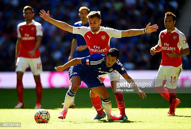Eden Hazard of Chelsea and Aaron Ramsey of Arsenal compete for the ball during the FA Community Shield match between Chelsea and Arsenal at Wembley...