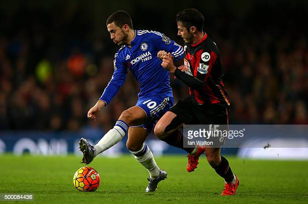 Eden Hazard of Chelsea and Adam Smith of Bournemouth compete for the ball during the Barclays Premier League match between Chelsea and AFC...