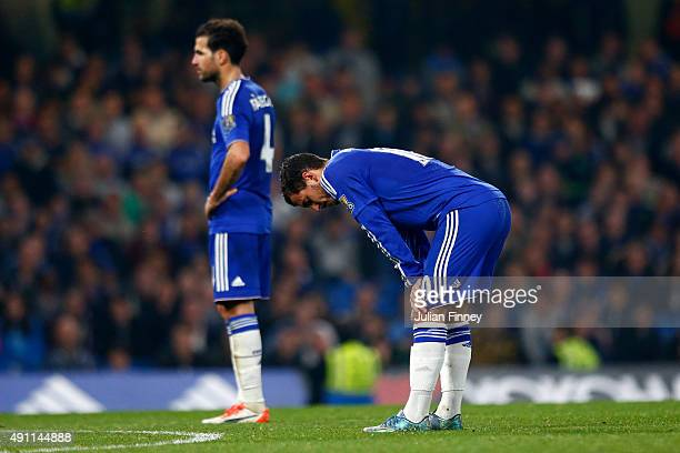 Eden Hazard of Chelsea and Cesc Fabregas of Chelsea show their dejection after conceding the third goal to Southampton during the Barclays Premier...