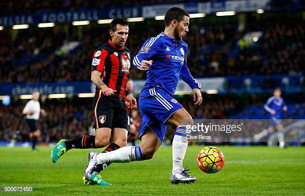 Eden Hazard of Chelsea and Charlie Daniels of Bournemouth compete for the ball during the Barclays Premier League match between Chelsea and AFC...