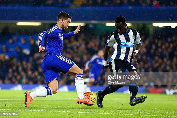 Eden Hazard of Chelsea and Cheik Ismael Tiote of Newcastle United compete for the ball during the Barclays Premier League match between Chelsea and...