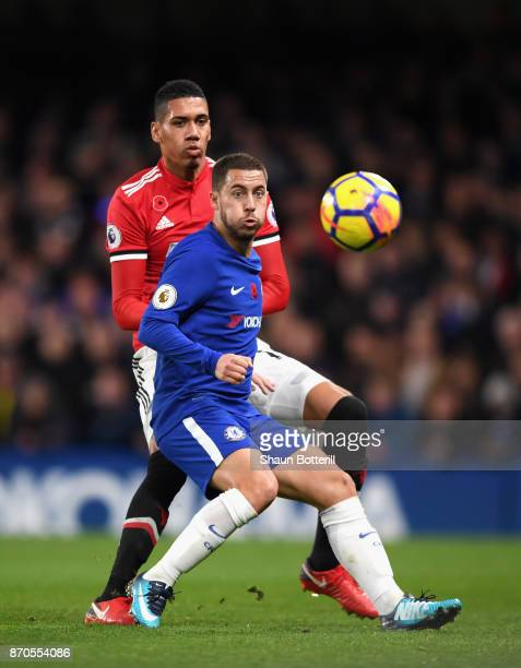 Eden Hazard of Chelsea and Chris Smalling of Manchester United battle for possession during the Premier League match between Chelsea and Manchester...