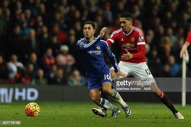 Eden Hazard of Chelsea and Chris Smalling of Manchester United during the Barclays Premier League match between Manchester Untied and Chelsea at Old...